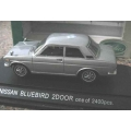 Ebbro Nissan Bluebird 2 door met. grey 1/43